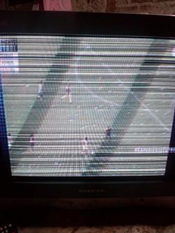 imagen adjunta de tv tonomac modelo TO-4-2141FT chasis px20172--1vg con interferencia